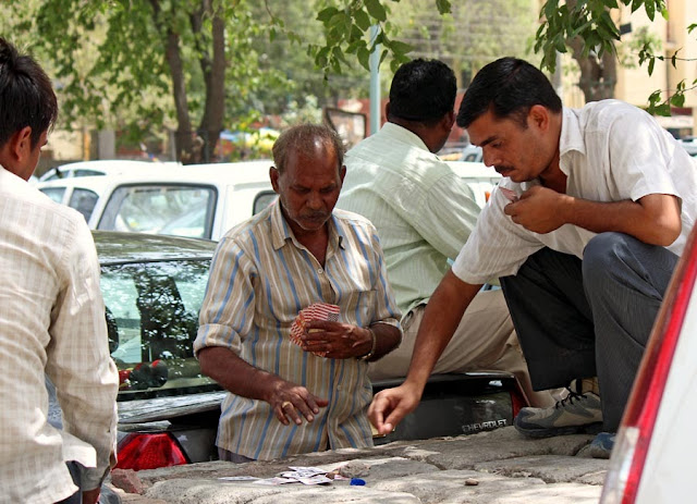 men gambling on the street