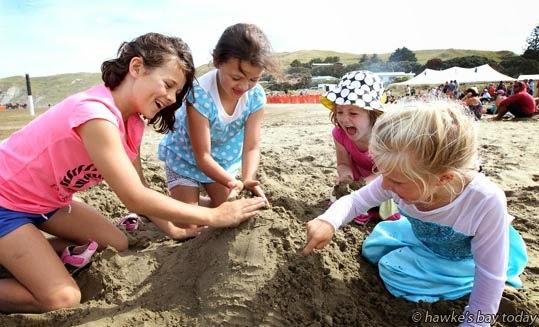 L-R: Hannah Tipene, 9, Mollie Tipene, 7, Ruby Tipene, 5, New Plymouth; Zoe Reisima, 4, Waipukurau, building a sand sculpture - Porangahau Beach Polo, Te Paerahi Beach, aka Porangahau Beach, Central Hawke's Bay. photograph