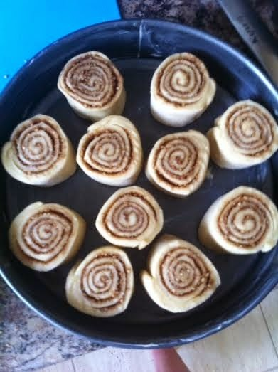 Cinnamon Rolls arranged in tin pre-rising