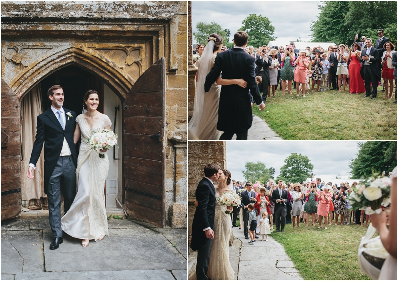Bride and groom walk out of church to greet guests
