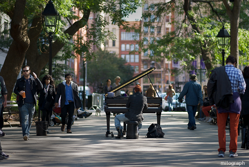 man plays piano at Washington Square Park of New York
