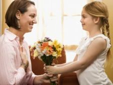 Girl gifting her mom flowers on Women's day