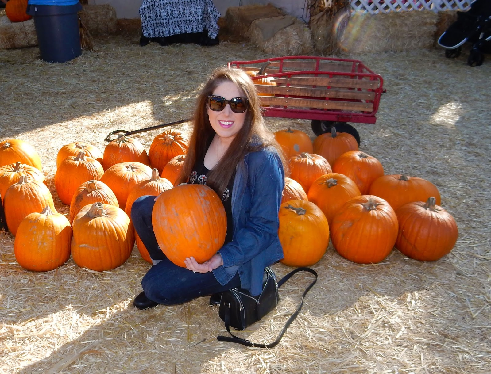 Marisa High Heeled Brenette with pumpkin at famous hollywood pumpkin patch