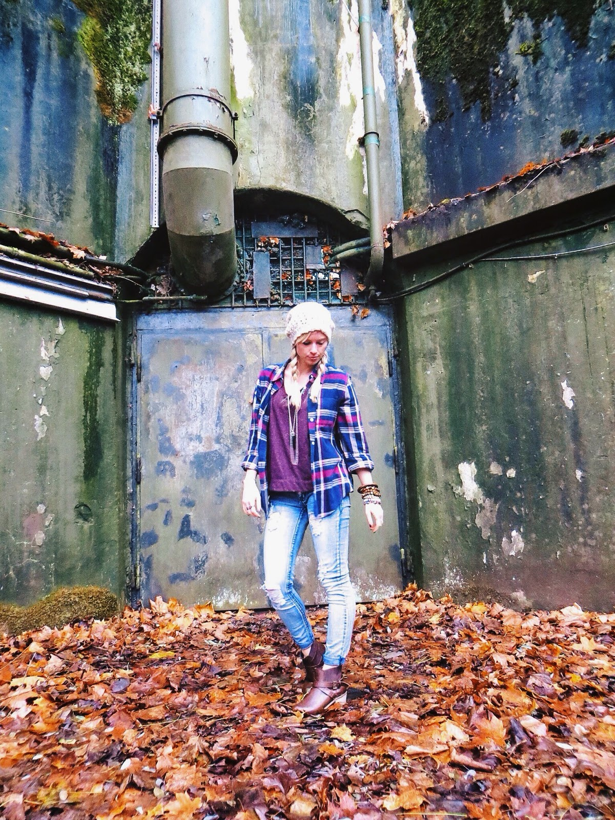 Plaid button down shirt, hi-low tee, destroyed jeans, western boots, beanie, swallow's heart horn necklace, casual outfit
