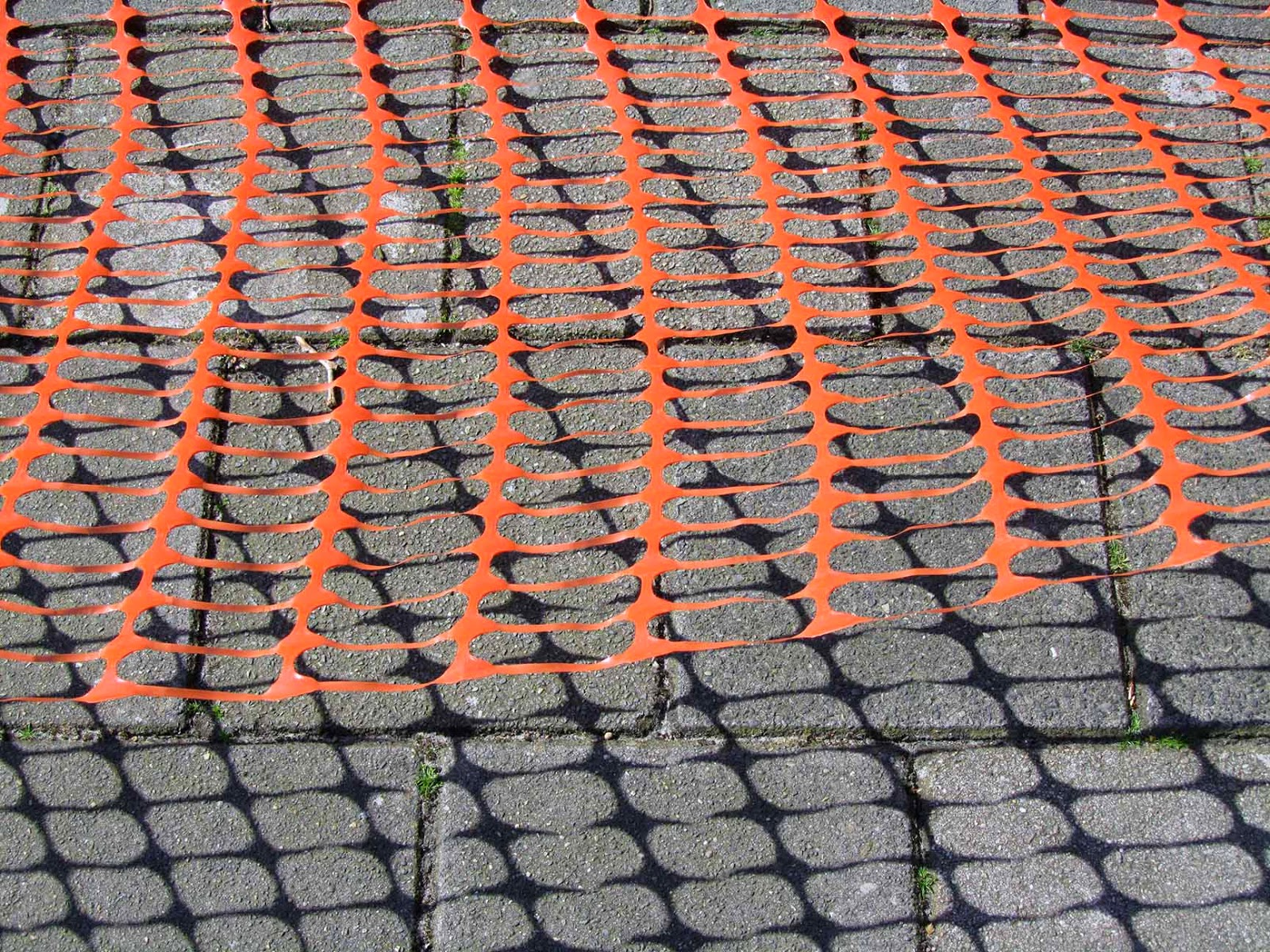 orange pattern on sidewalk