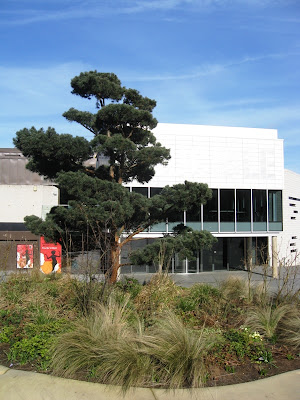 A theatre with a tree in front of it