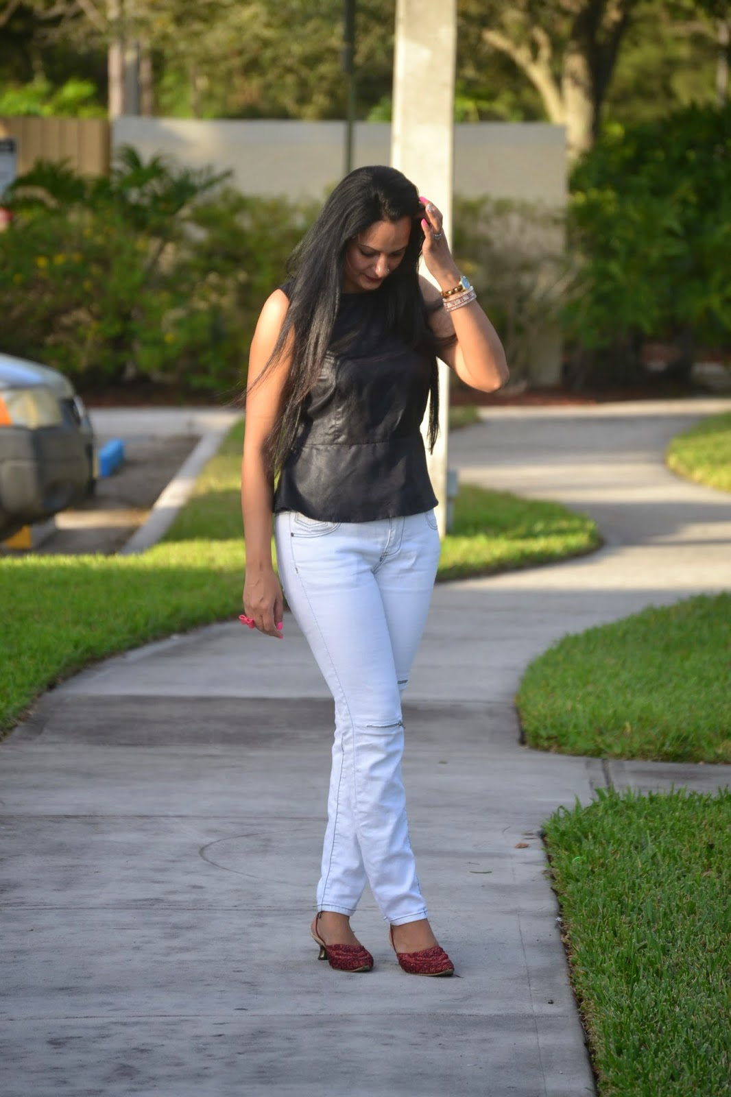 How To Wear Black And White faux leather peplum top white ripped skinny jeans red kitten heels www.sandysandhu.co