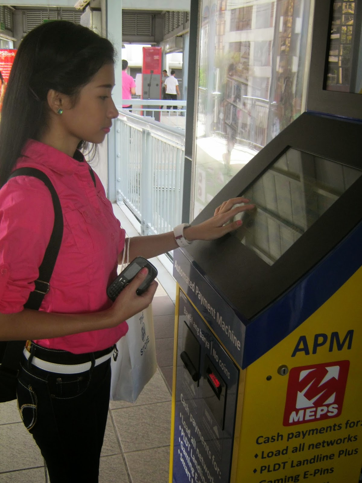 GCash customer makes a cash-in transaction using MEPS Automated Payment Machine