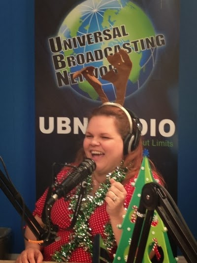 Jenna Edwards wears tinsel and reindeer antlers for Candycane's guest appearance on her talk show, Create Your Life with Jenna Edwards.