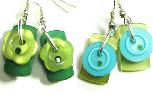 Bold earrings have cute buttons layered over colorful rectangular buttons