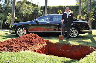 Dumb ! Businessman buries his £310,000 bentley so he can use it in