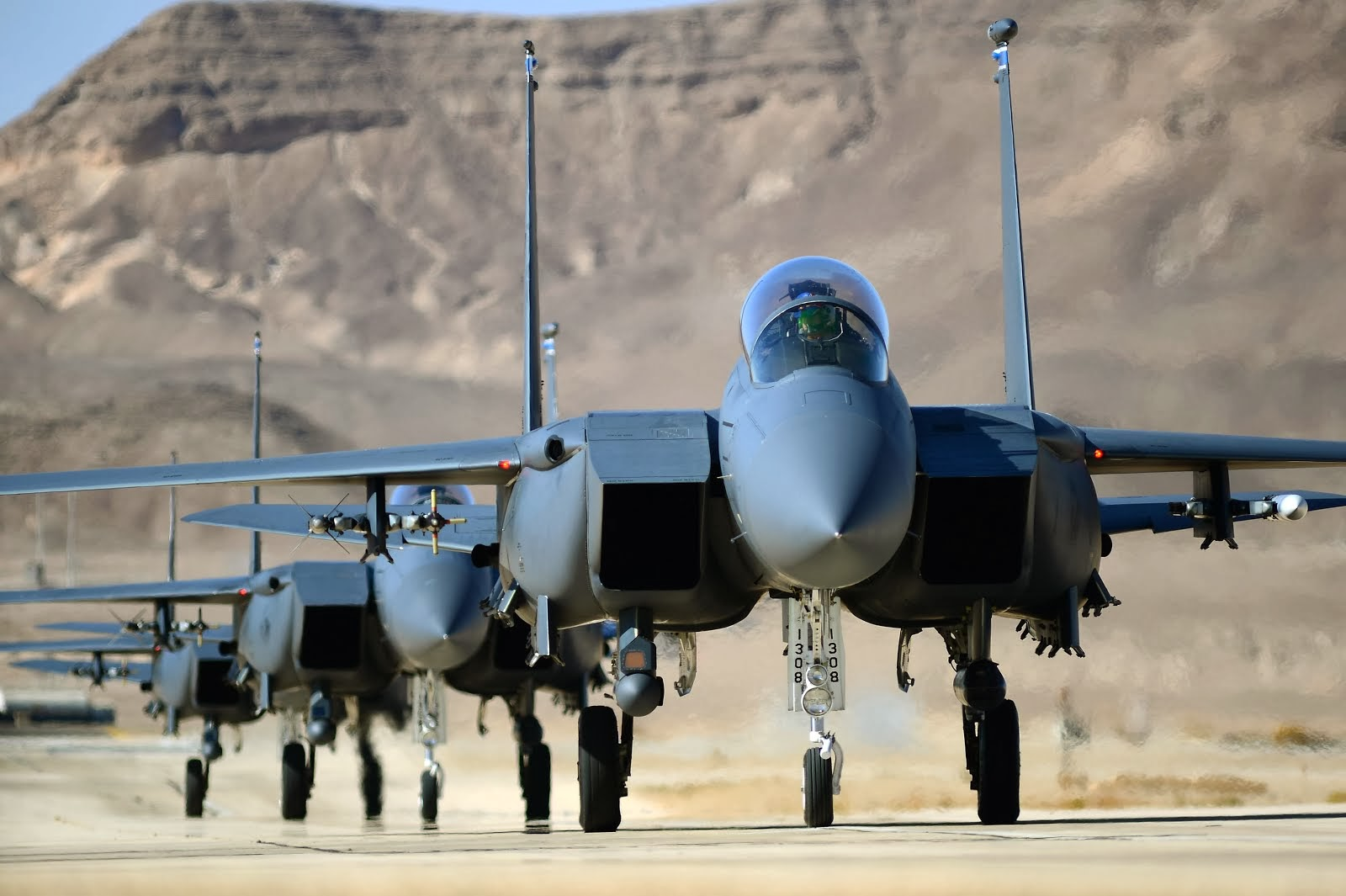 F-15E STRIKE EAGLES TAXI ON UVDA AIR FORCE BASE, ISRAEL