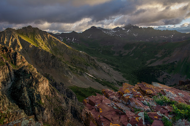 Photograph of Colorado 14er Castle and Conundrum Peak at sunrise in the Elk Mountains