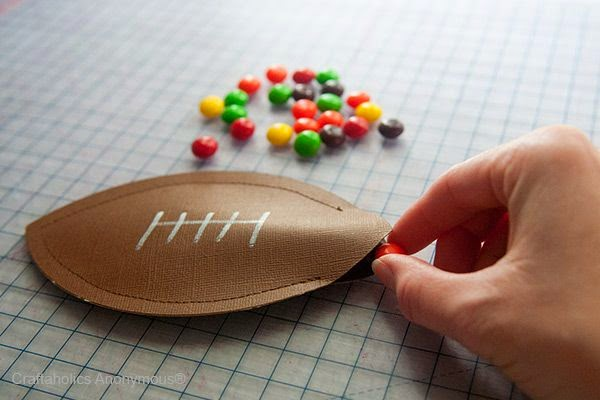 http://www.craftaholicsanonymous.net/football-craft-diy-candy-pouches