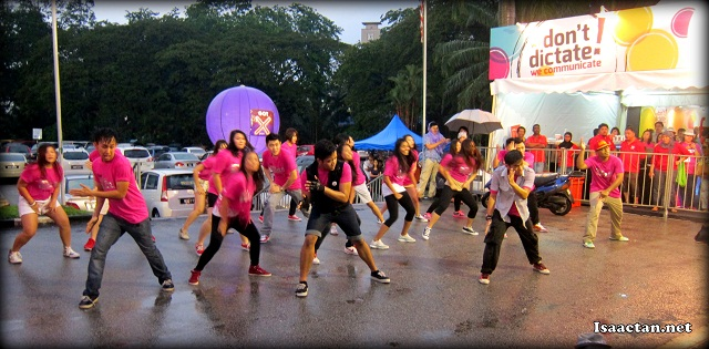 A flash mob outside Stadium Merdeka dancing in the rain