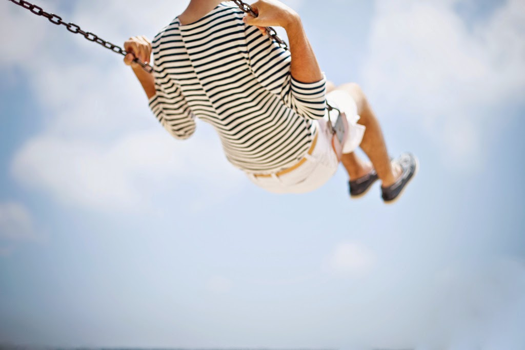girl on swing in the summer