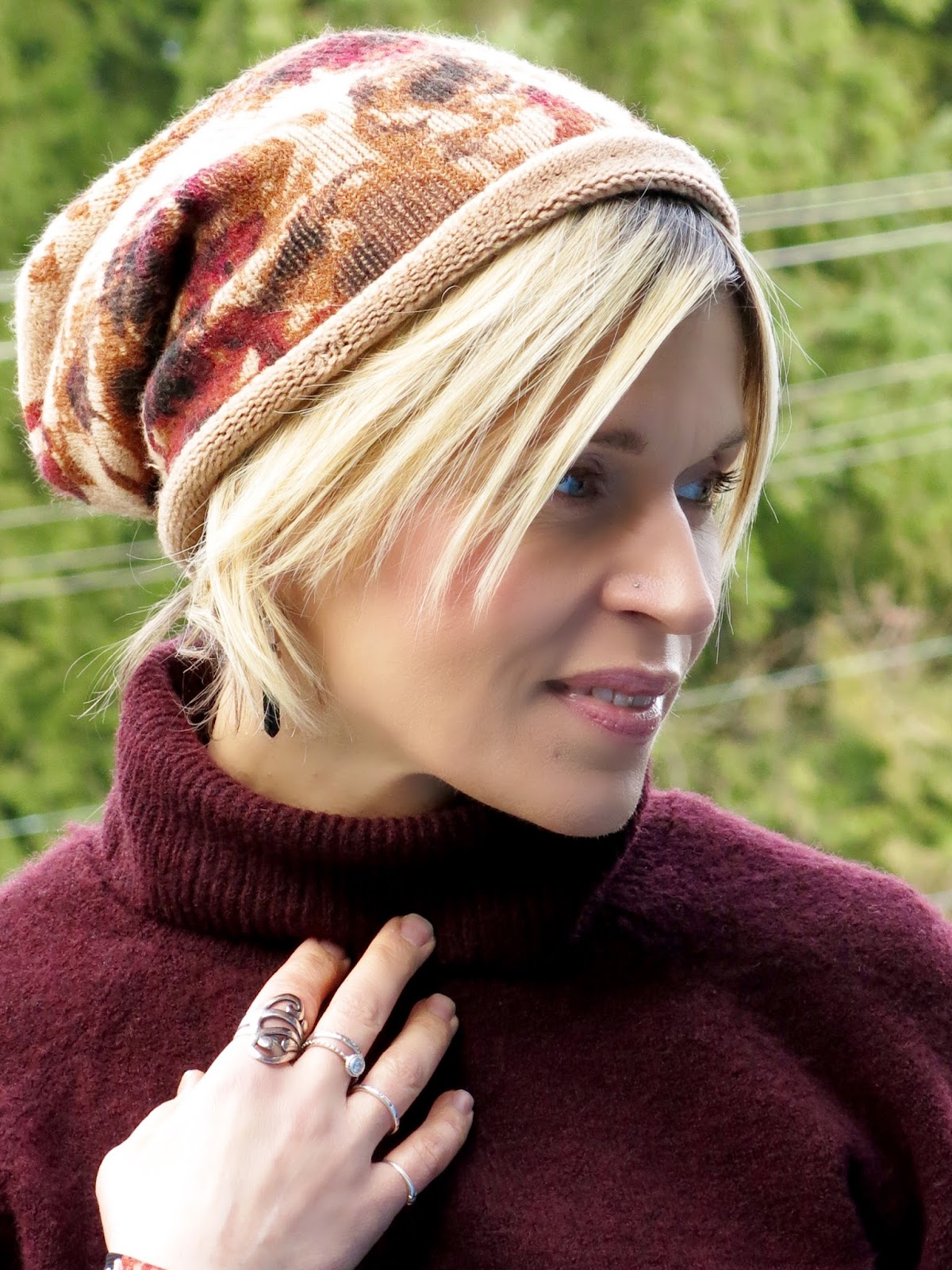 chunky maroon turtleneck sweater, floral beanie