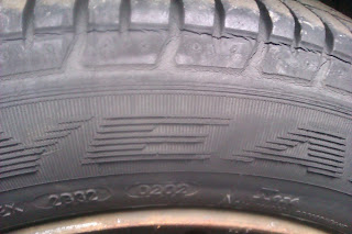 image: car tyre showing the dot code