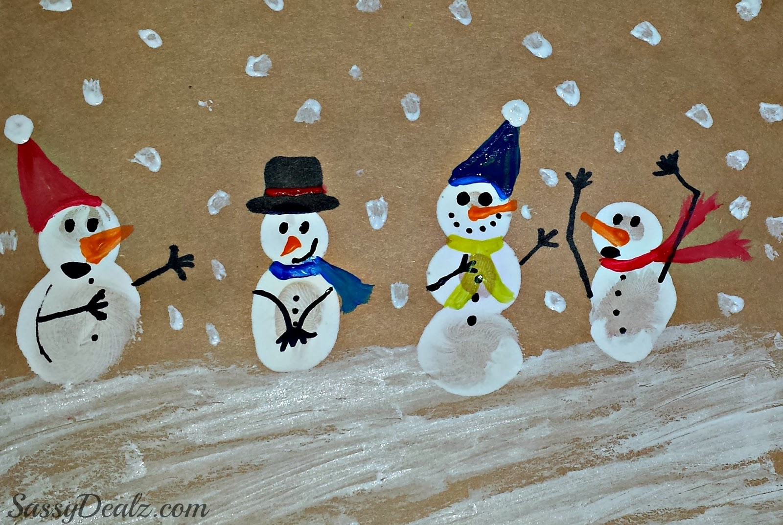 To finish off these cute snowmen we painted on hats and scarves with