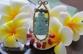wire wrap Ganesha pendant , turquoise and coral , handcrafted wirewrap pendant