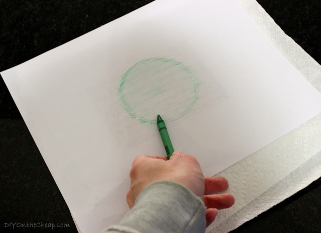 Trace lid with a crayon to cut paper to the right size.
