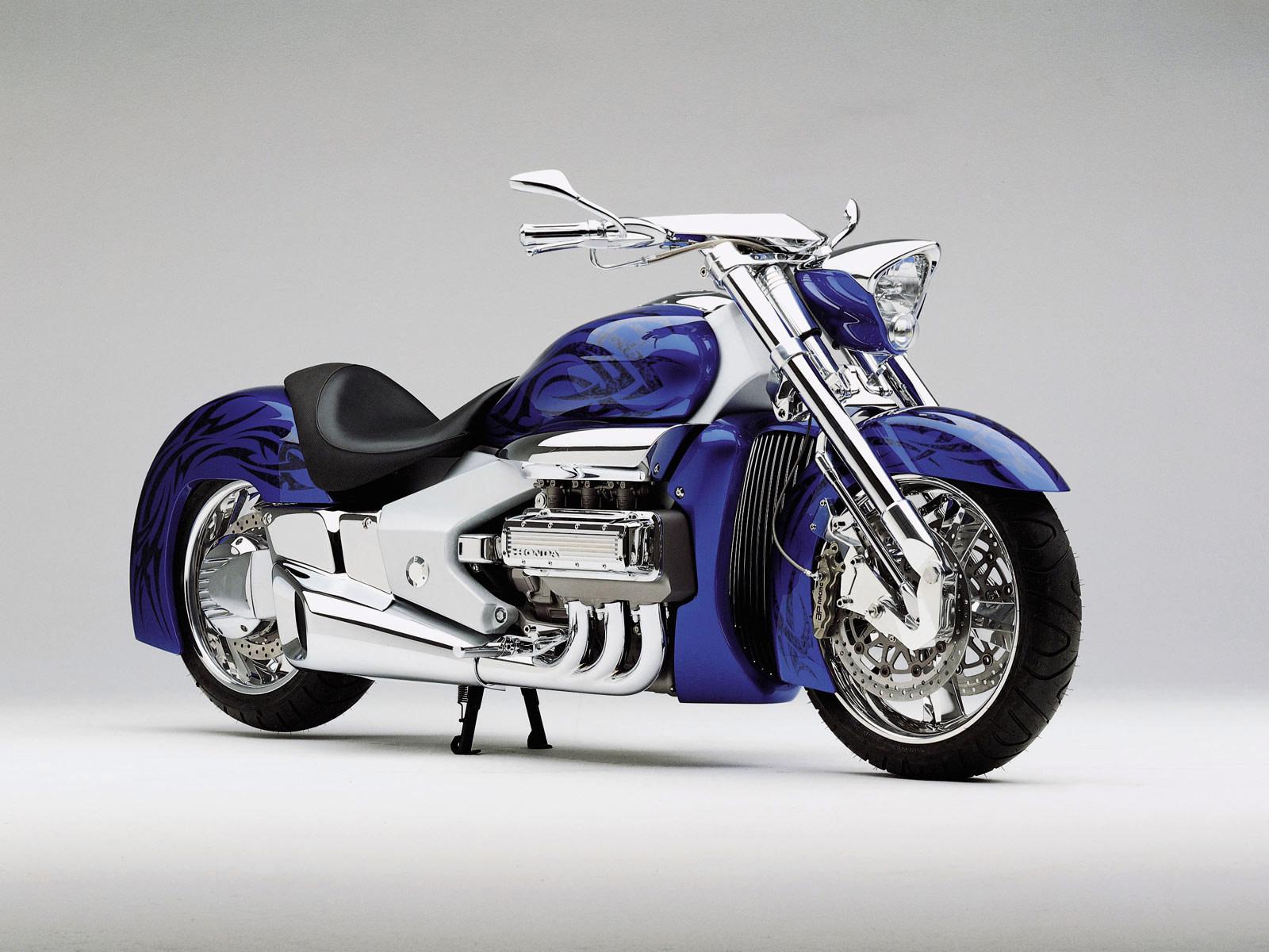 http://4.bp.blogspot.com/-YNphFH8IZjo/TiUPE-45e0I/AAAAAAAAAKY/rrJ9zFjpF_M/s1600/honda_T2_Concept_2000_car-desktop-wallpaper_05.jpg