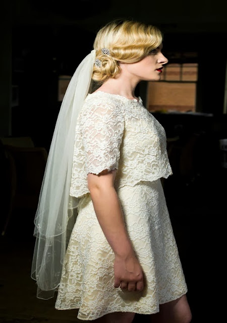 Side view of William Cahill white mini in lace, with integral cape. c HVB vintage wedding blog 2013