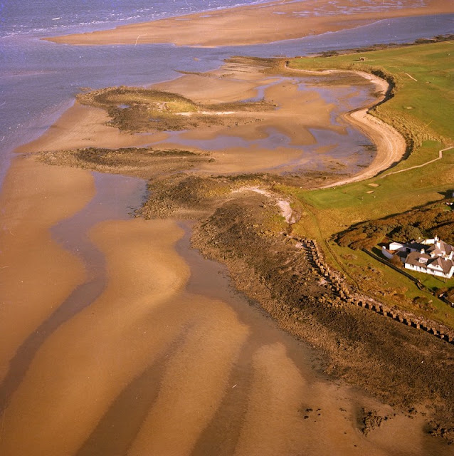 Oblique aerial view of Craigielaw Point, Aberlady. East Lothian. Looking north-west. Bedded sediments. Lower Limestone Group. The Lower Limestone Group is the uppermost division of the Lower Carboniferous in the district. The strata has a regional dip to the west or north-west of up to 5 degrees, though between Craigielaw Point and Aberlady Point gentle minor folds are superimposed on the larger structure. Note the concrete anti-landing defences from World War 2.