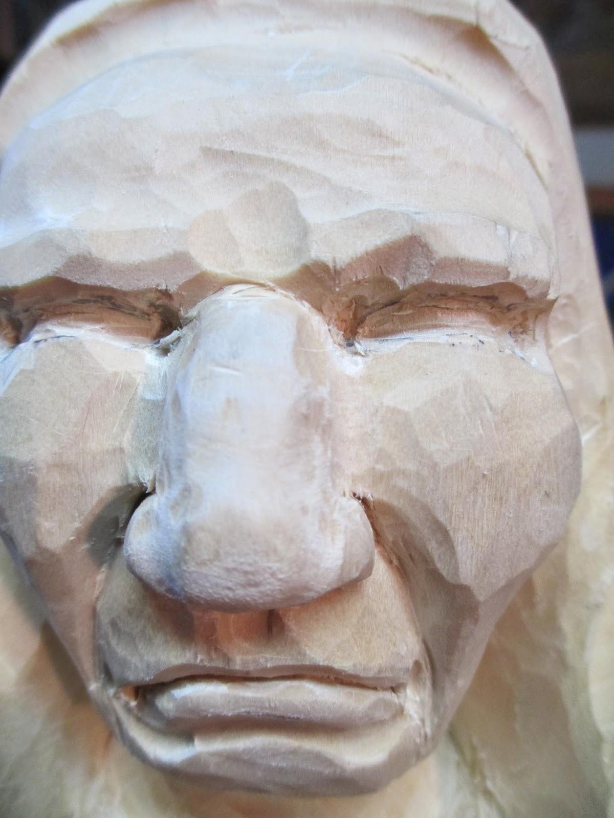 Knotty wood spirits carving an eye
