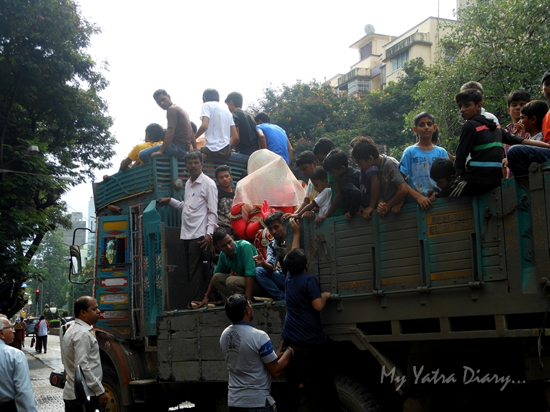 Ganesha being carried in truck, Ganesh Chaturthi Festival, Mumbai