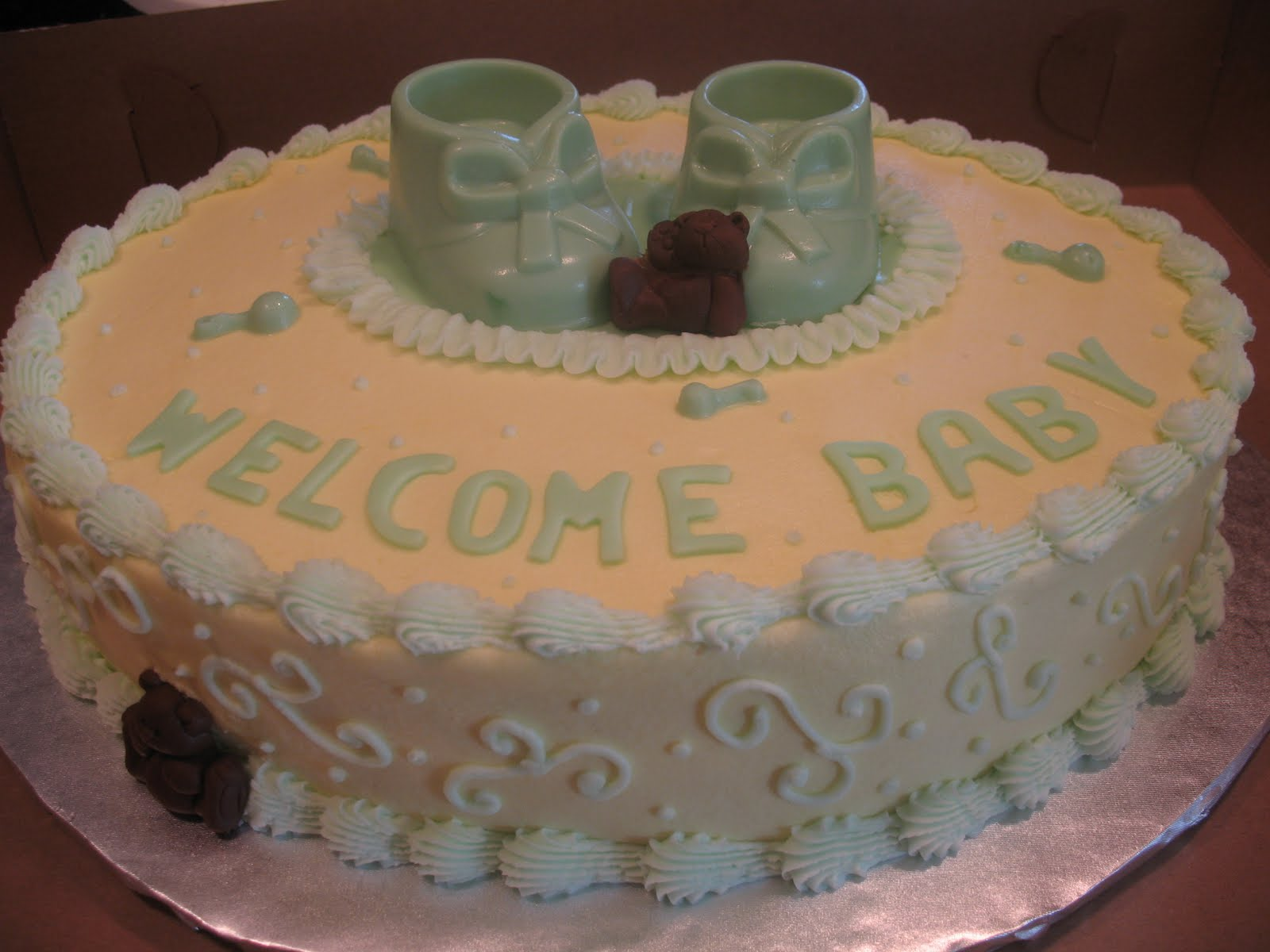 this baby shower cake is a almond pound cake covered in buttercream ...