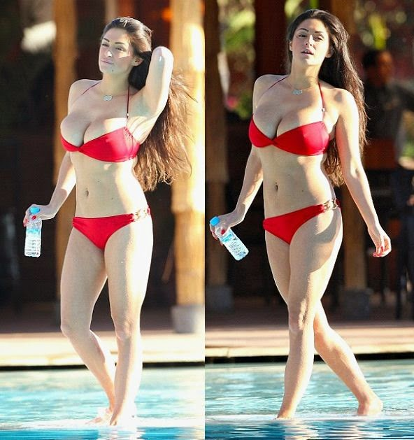Looking sleek for the day, the 29-year-old was nothing short of stunning in her low cut two-piece as she enjoyed a poolside by herself in Ibiza on Monday, June 28, 2014.