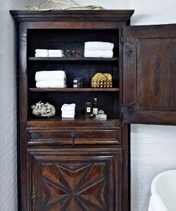 The Warmth Of The Rich, Old Wood Of The Armoire Helps To Offset The  Coldness Of All The Metal, Giving The Bathroom A Warm Inviting Feel.