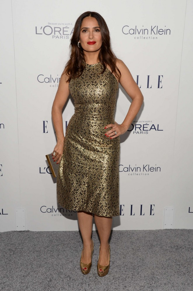Salma Hayek shows curves in a metallic dress at the Elle Women in Hollywood Awards