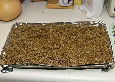 coarse acorn meal ready for oven drying