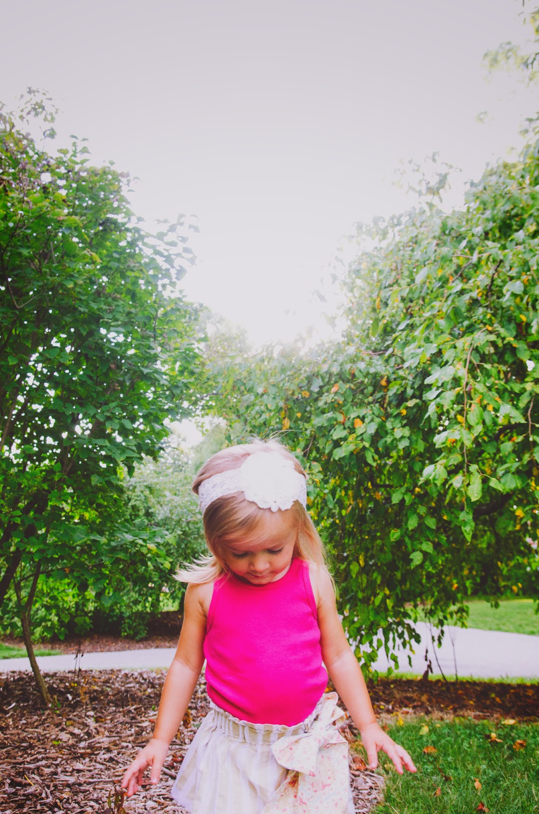 boho girl in pink with lace headband at indy family session