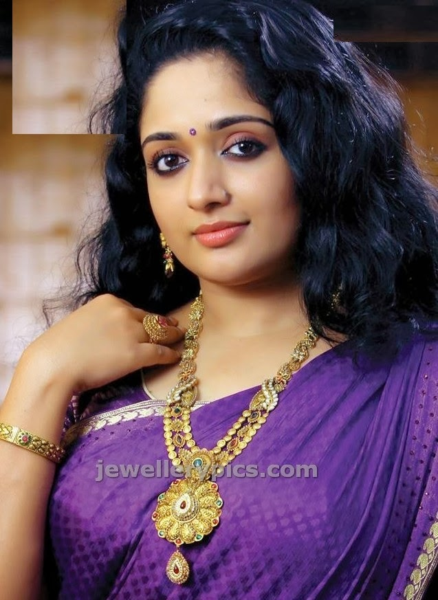 actree kavya madhavan in antique gold haram by dubai gold and diamonds