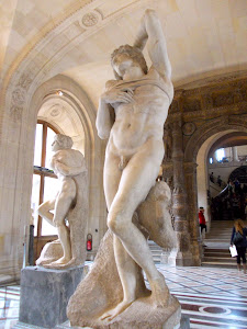 Michelangelo's two unfinished slaves.  The Louvre. Wow. Photo by Linda, if you know what I mean!