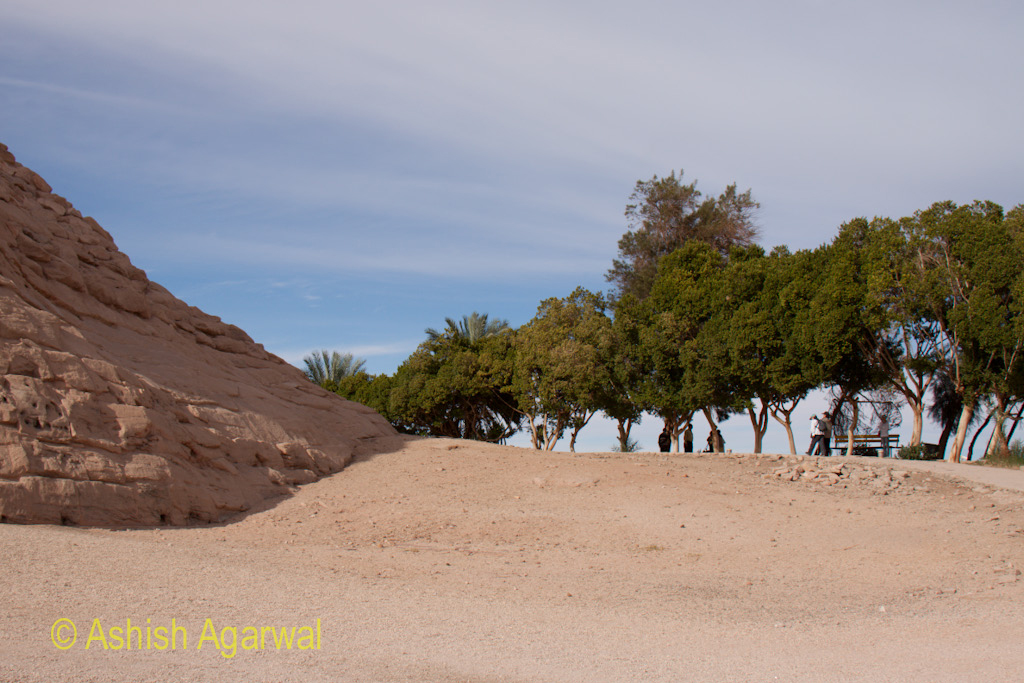Trees and a path around the hillocks that contain the Abu Simbel temple in Egypt