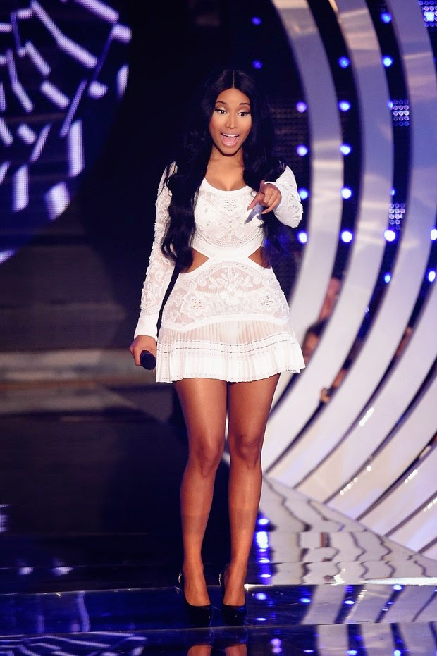 The low cut white dress, Roberto Cavalli, was another look from Nicki Minaj in the EMA
