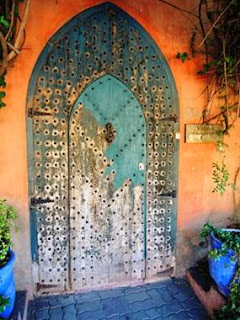 ancient door, Marrakech, blue posts