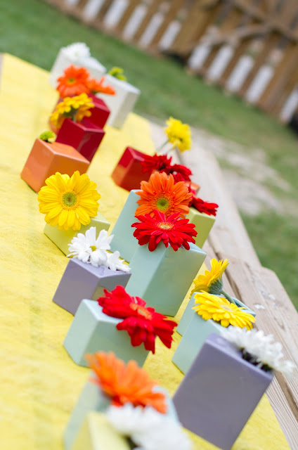 colorful budvases with gerber daisies