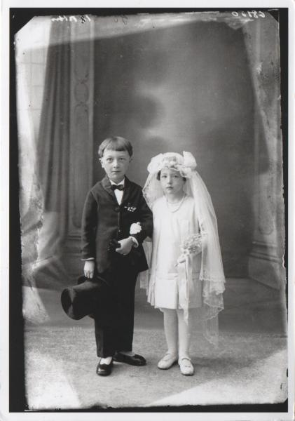 black and white picture of girl and boy in first communion outfits