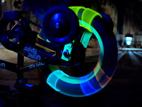 place glow sticks around bike wheels and vary the speed you spin the wheel to reveal beautiful glowing art
