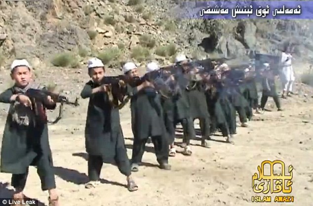 Made to kill: Children as young as five fire assault rifles at a terror training camp in north Waziristan