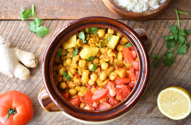 This recipe for Creamy Curried Chickpeas with Potatoes is both vegan and gluten-free. It can be ready in under an hour and most of that time is cooking time, so you can be doing other things (like browsing Instagram or catching snippets of your fave show on Netflix). #vegan #wholefoods #glutenfree #healthy #plantbased  #recipe