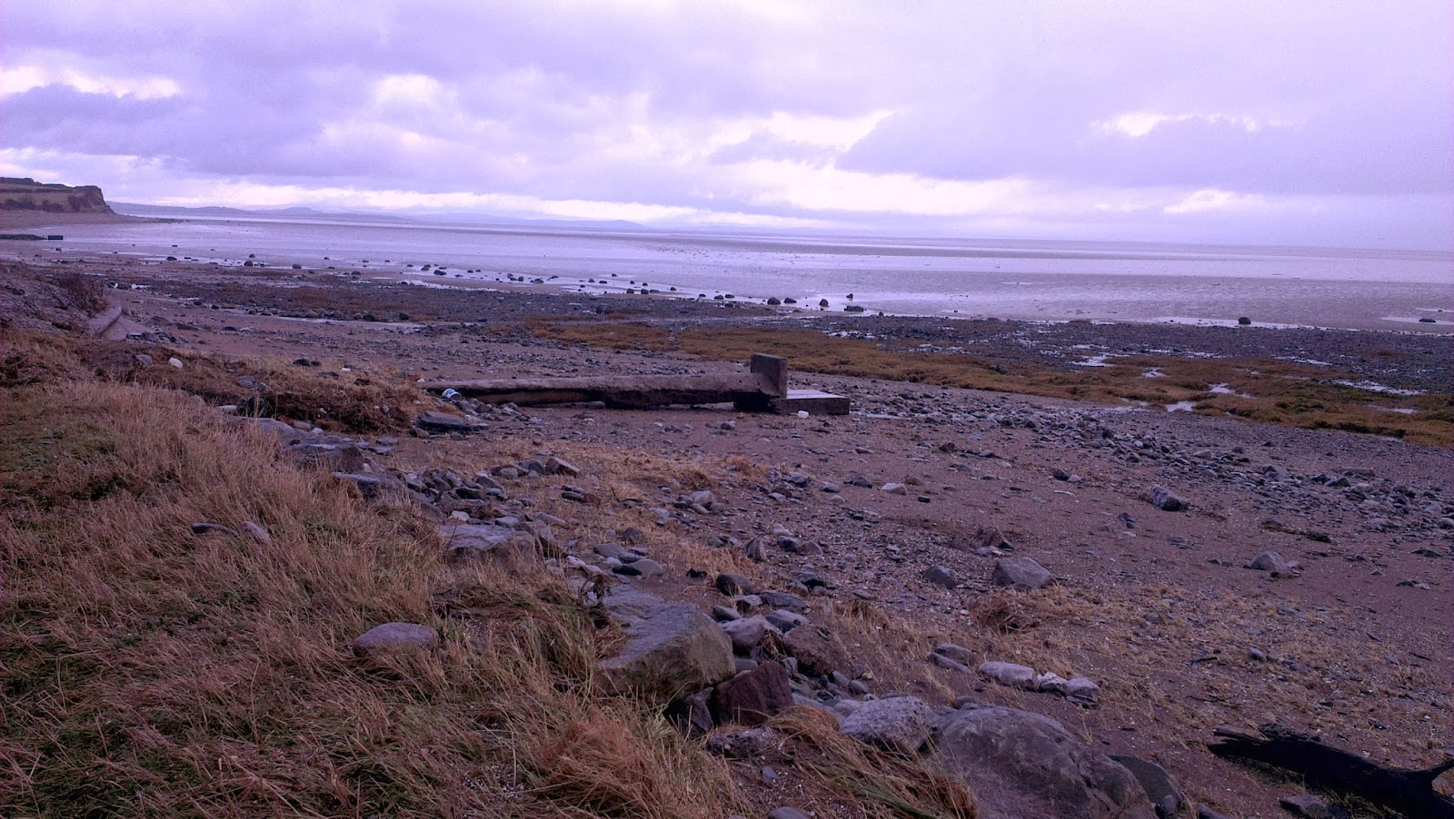 Various rocks and debris have been dumped by the tide