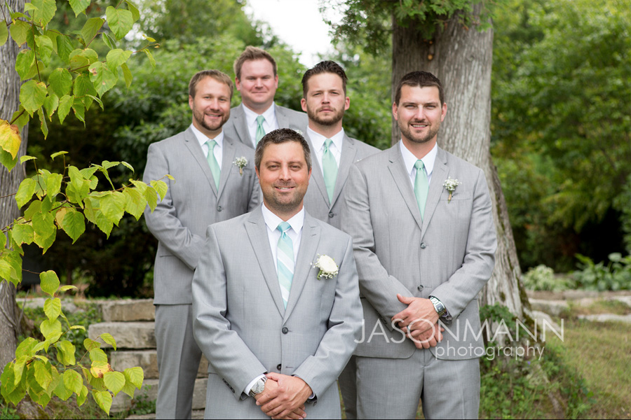Door County groom and groomsmen in gray suits with teal ties by Calvin Klein and Perry Ellis. Photo by Jason Mann Photography, 920-246-8106, www.jmannphoto.com