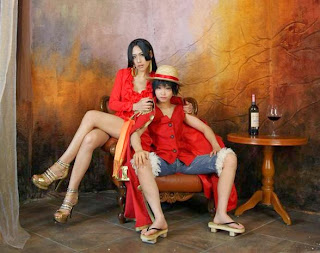 Tomia and Tasha cosplay as Luffy and Boa Hancock from One Piece
