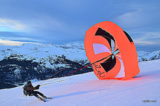 Uphill skiing with a parachute sounds interesting